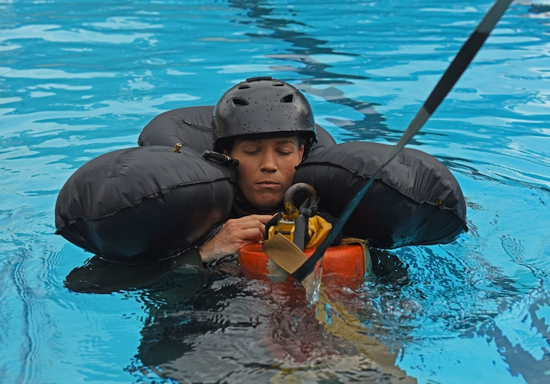 U.S. Air Force Capt. Zoe Kotnik, 55th Fighter Squadron chief of training, simulates being pulled out of water by a rescue helicopter at Shaw Air Force Base, S.C., July 19, 2018.