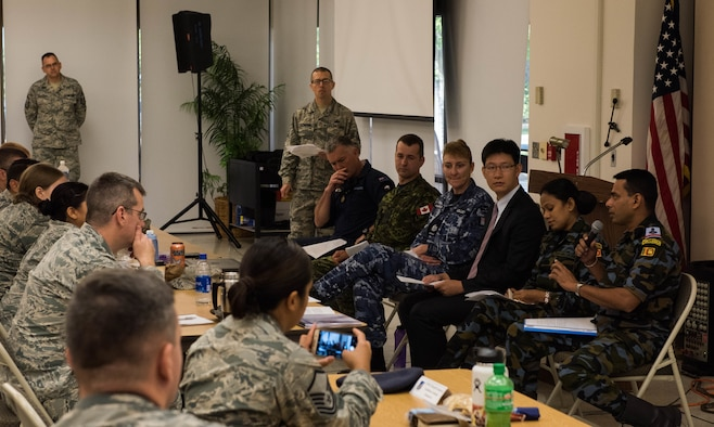 Airmen ask questions and gain an understanding of how situations and tasks are approached differently in other countries during the 2018 Team Hickam First Sergeants Symposium on Joint Base Pearl Harbor-Hickam, Hawaii, July 19, 2018.