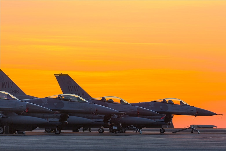 A line up of U.S. Air Force F-16Cs, assigned to the 14th Fighter Squadron, Misawa Air Base, Japan, sit on the tarmac at Royal Australian Air Force (RAAF) Base Darwin during Exercise Pitch Black 16, August 4, 2016. Pitch Black is a biennial multinational air warfare exercise hosted by the RAAF that focuses on offensive counter air and defensive counter air combat in a simulated war environment.