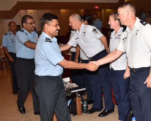 Indian Air Force Air Vice Marshall Mahendra Vikram Singh, commander of the Indian air force command hospital in Bengaluru, shakes hands with U.S. Air Force Lt. Col. Daniel Roberts, Pacific Air Forces Aviation management Branch chief, during the opening ceremony of a recent U.S. Air Force and Indian air force subject matter expert exchange (SMEE) at the Institute of Aviation Medicine in Bengaluru, India, in late June 2018. The four-day inaugural, bilateral exchange was designed to facilitate an understanding of the medical capabilities that each service brings to the table. (Courtesy photo)