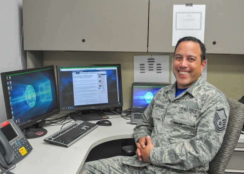 Master Sgt. Robert Beveridge, non-commissioned officer in charge of the 910th Communications Squadron's cyber systems operations section, poses for a photo at his workstation here, July 14.