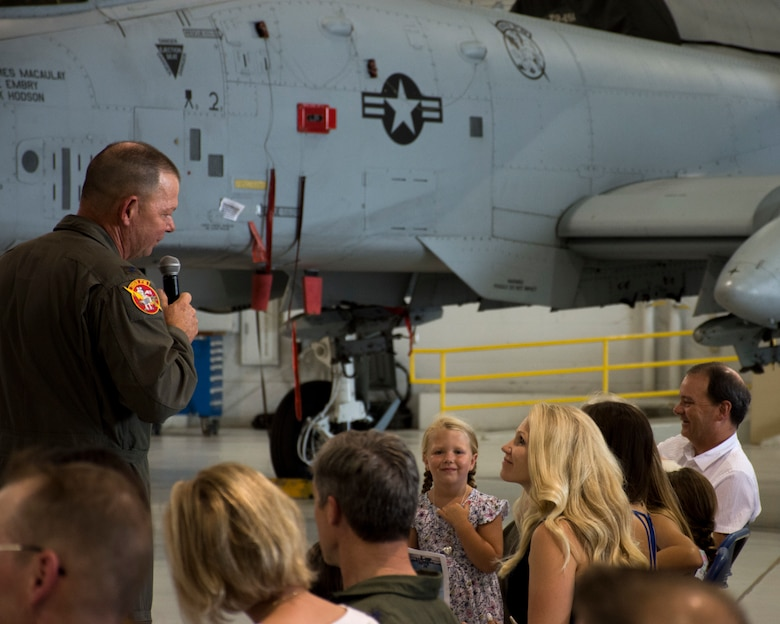 Col. Jim Macaulay addresses his wife, Kris, at his retirement ceremony.