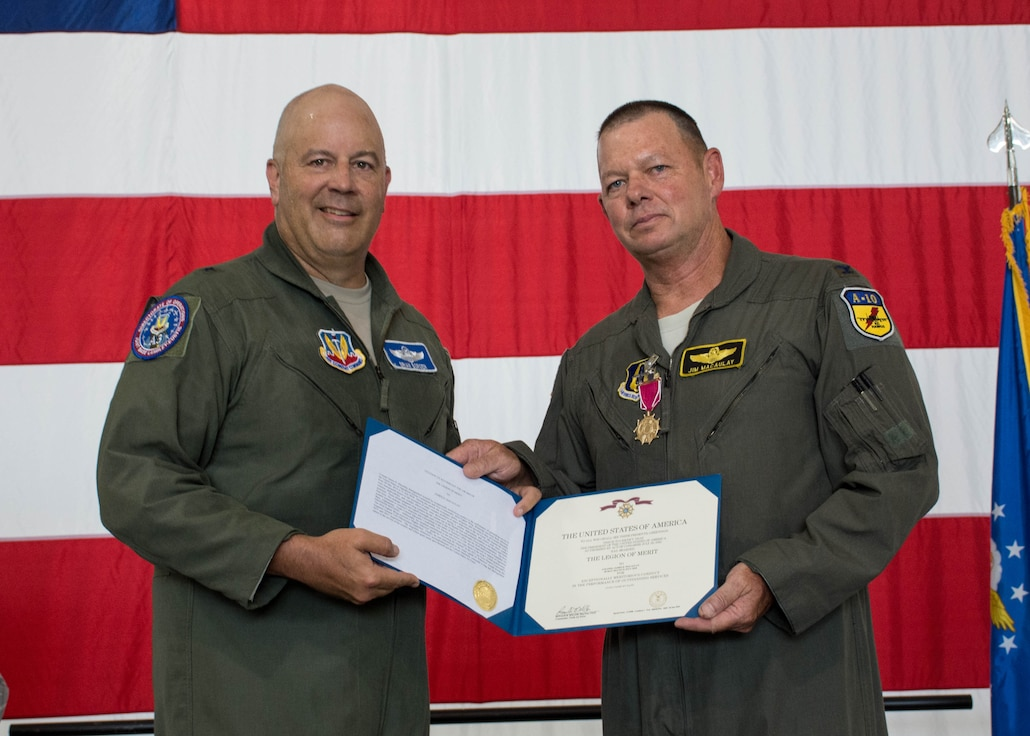 Brig. Gen. Brian K. Borgen presents Col. Jim Macaulay a retirement certificate July 14, 2018, at a retirement ceremony at Whiteman Air Force Base, Mo. Macaulay is scheduled to retire July 28, 2018, after 34 years of service. (U.S. Air Force photo by Senior Airman Missy Sterling)