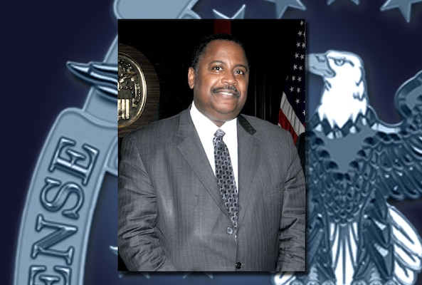 A portrait of Larry Glasco with a detail view of the DLA emblem in the background