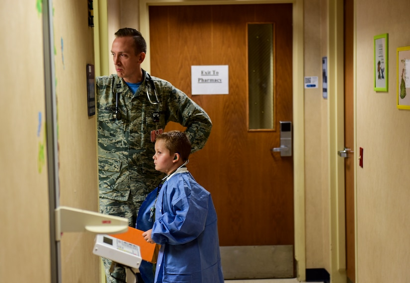Caleb Pettit, 9, looks into the examination room while playing doctor, July 20, 2018, at Joint Base Charleston, S.C.