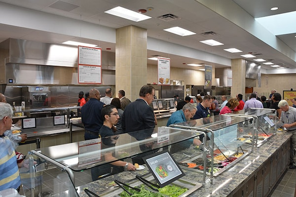 Employees sample free salad bar at soft opening of Center Restaurant July 23, 2018.