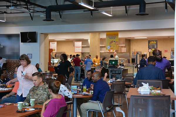 Employees enjoy free food samples at soft opening of Center Restaurant July 23, 2018.