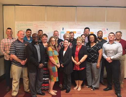 Eighteen Performance Improvement Officers, also known as PIOs, graduated from the Defense Contract Management Agency's one-week green belt training on May 25. The training will help employees lead teams to update business processes across the agency. (DCMA photo by Andrew Miskovich)