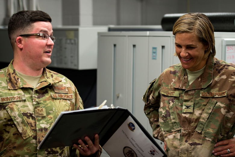Staff Sgt. Andrew McIntosh, left, 347th Rescue Group training manager, briefs Col. Jennifer Short, 23d Wing commander, prior to a simulated exercise during an immersion tour, July 23, 2018, at Moody Air Force Base, Ga. During the immersion, Short visited with Survival, Evasion, Resistance, Escape (SERE) and medical specialists from the 347th Operations Support Squadron (OSS). The 347th OSS rescue training center houses both independent duty medical technician paramedics and SERE specialists, whose mission is to train and equip Airmen to be able to survive and save lives while in austere environments. (U.S. Air Force photo by Airman 1st Class Erick Requadt)