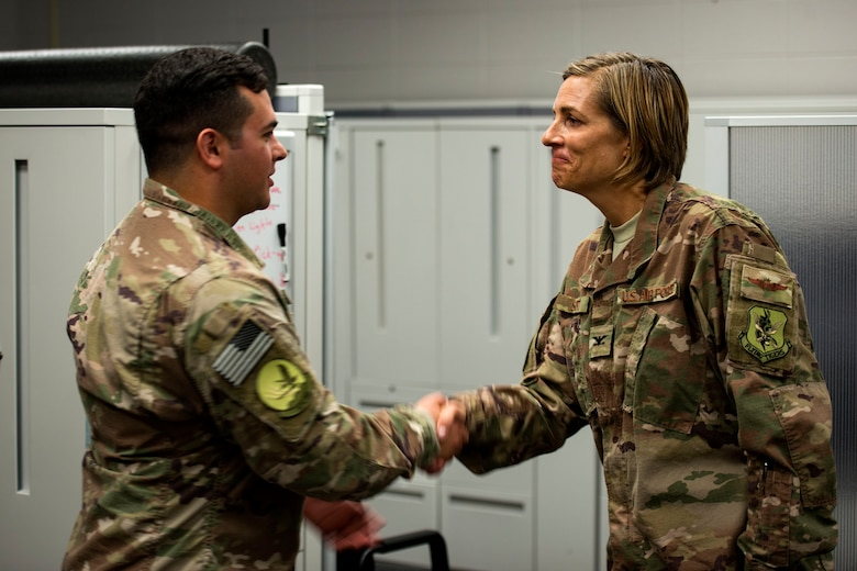Col. Jennifer Short, right, 23d Wing commander, coins Staff Sgt. Michael Triana, 347th Operations Support Squadron (OSS) independent duty medical technician (IDMT) paramedic, during an immersion tour, July 23, 2018, at Moody Air Force Base, Ga. During the immersion, Short visited with Survival, Evasion, Resistance, Escape (SERE) and medical specialists from the 347th OSS. The 347th OSS rescue training center houses both IDMT paramedics and SERE specialists, whose mission is to train and equip Airmen to be able to survive and save lives while in austere environments. (U.S. Air Force photo by Airman 1st Class Erick Requadt)