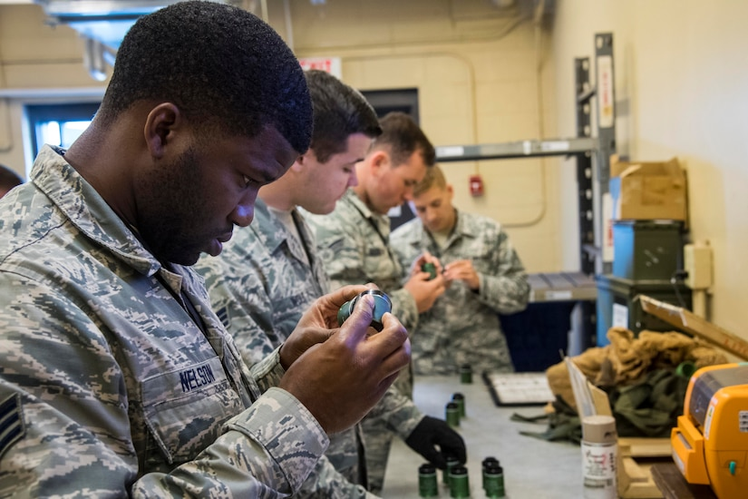 Munition inspectors from the 23rd Maintenance Squadron examine 40 mm projectile explosive shells at Moody Air Force Base, Ga., July 10, 2018. Munitions inspectors enhance Moody's combat capabilities by inspecting and approving safe and serviceable ammunition. Air Force photo by Airman 1st Class Eugene Oliver
