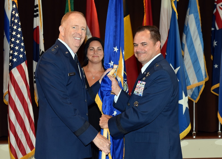 Lt. Gen. Robert McMurray, Air Force Lifecycle Management Center commander, passes the U.S. Air Force flag to Brig. Gen. Sean Farrell as he assumes command of the Air Force Security Assistance and Cooperation Directorate at Wright-Patterson Air Force Base, Ohio, July 18, 2018. Farrell's previous assignment prior to commanding AFSAC was Director, Strategic Plans, Programs and Requirements, Air Force Special Operations Command, Hurlburt Field, Florida. (U.S. Air Force photo by Al Bright)