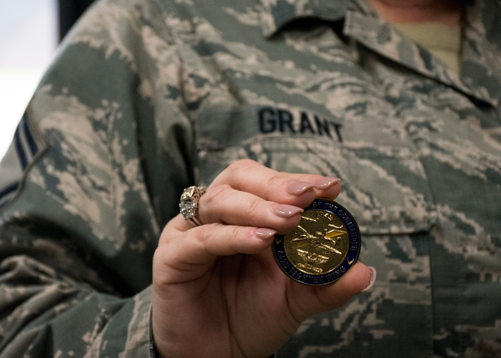 Senior Master Sgt. Rachel Grant, superintendent of medical administration with the 442d Medical Squadron, holds a coin July 24, 2018, at Whiteman Air Force Base, Mo. Col. Roger Suro, the 442d Fighter Wing commander, coined Grant for her hard work and help throughout the wing July 13, 2018. (U.S. Air Force Photo by Senior Airman Taylor Davis)