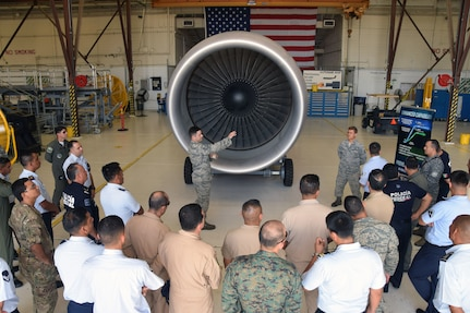 Tech. Sgt. Corey D. Murphy, 433rd Maintenance Squadron aerospace propulsion technician, briefs 40 students from the Inter-American Air Forces Academy ,on the new GE CF6-80C2 turbofan engine that the C-5M Super Galaxy aircraft uses July 18 at Joint Base San Antonio-Lackland. IAAFA students are from Latin American nations who study courses taught in Spanish in subjects ranging from professional military education, operations and support to aircraft and systems training.