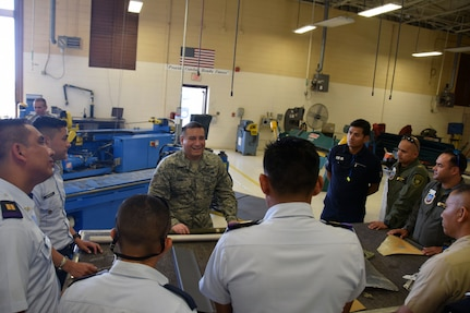 Tech. Sgt. Edgar Torres, 433rd Aircraft Maintenance Squadron sheet metal technician, explains to students from the Inter-American Air Forces Academy, how he repairs the metal on a C-5M Super Galaxy July 18 at Joint Base San Antonio-Lackland. Torres, who gave his briefing in Spanish, also explained how he fabricates parts for the aircraft at another area in his work station.