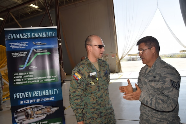 Tech. Sgt. William T. Holland, 433rd Maintenance Squadron jet engine mechanic, talks with 2nd Lt. Ivan Torres, an Ecuadorean Air Force maintenance officer, about the new GE CF6-80C2 turbofan engine the C-5M Super Galaxy aircraft uses July 18 at Joint Base San Antonio-Lackland. Inter-American Air Forces Academy students, like Torres, are from Latin American nations who study courses taught in Spanish in subjects ranging from professional military education, operations and support to aircraft and systems training.