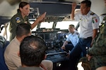 U.S. Air Force Maj. Brandi King, 356th Airlift Squadron C-5M Super Galaxy instructor pilot, talks with students from the Inter-American Air Forces Academy July 18 at Joint Base San Antonio-Lackland. The students are senior maintenance officers in their respective countries' air forces from Latin America.