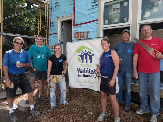 Global Vikings volunteer at Habitat for Humanity project in West St. Paul July 20. From left are Tom O'Reilly, Matt Welage, Master Sgt. Kelly Conley, Staff Sgt. Kayla Bowell, John Rudin and Col. Tim Wollmuth. (Air Force Photo/Paul Zadach)