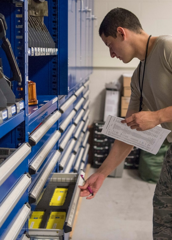 Airman 1st Class Daren Abad, a 525th Aircraft Maintenance Unit F-22 Raptor crew chief support technician, performs tool and equipment inventory at Joint Base Elmendorf-Richardson, Alaska, July 19, 2018. Abad is responsible for the issue and control of more than 10,000 tools during one of three shift inventories.