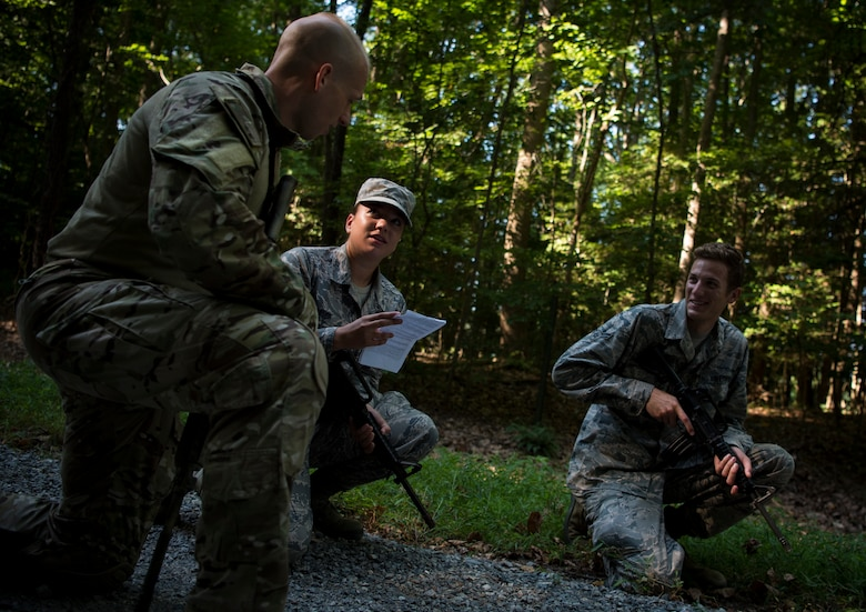 U.S. Air Force Airmen assigned to the 633rd Civil Engineer Squadron practice individual movement techniques during Prime Base Engineer Emergency Force training at Joint Base Langley-Eustis, Virginia, July 19, 2018.