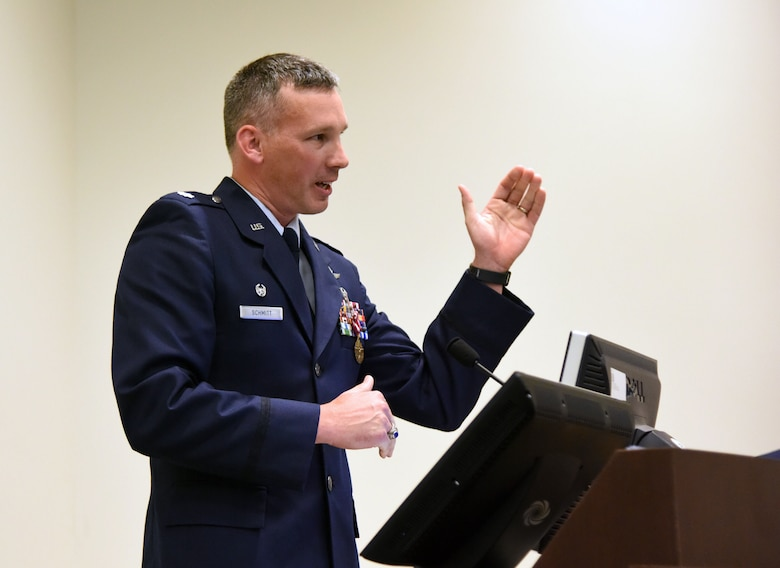 U.S. Air Force Lt. Col. Daniel Schmitt, outgoing 336th Training Squadron commander, delivers remarks during the 336th TRS change of command ceremony in the Roberts Consolidated Aircraft Maintenance Facility at Keesler Air Force Base, Mississippi, July 23, 2018. Schmitt relinquished command to Maj. Jill Heliker, incoming 336th TRS commander. (U.S. Air Force photo by Kemberly Groue)