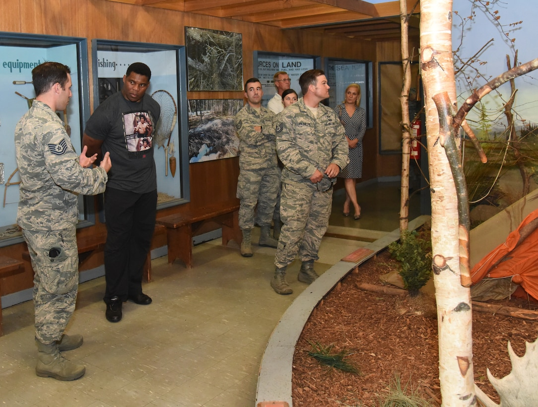 Herschel Walker receives a tour of the Survival Evasion Resistance and Escape training labs during a base visit July 18, 2018, at Fairchild Air Force Base, Washington. Walker was diagnosed with Dissociative Identity Disorder, and used his experience to champion ways to change perspectives about mental health. (U.S. Air Force/Staff Sg. Samantha Krolikowski)