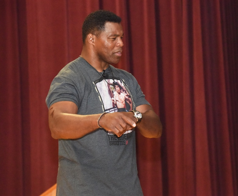 Herschel Walker talks with Airmen on the importance of getting help and not being afraid to speak up about mental health challenges July 18, 2018, at Fairchild Air Force Base, Washington. Walker was diagnosed with Dissociative Identity Disorder, and used his experience to champion ways to change perspectives about mental health. (U.S. Air Force photo/Staff Sgt. Samantha Krolikowski)