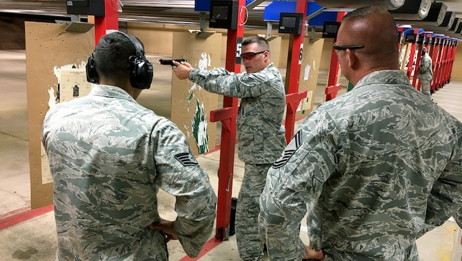 Tech. Sgt. Jared Jeppsen, 419th Security Forces Squadron, gives shooting tips to teammates set to compete in the International Bavarian Military Competition in Germany this week.