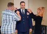 Brother and wife pin new rank on Col. Malec