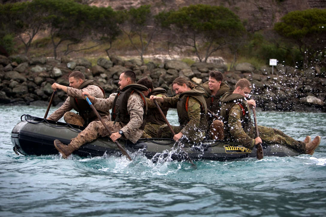 U.S. Marines and sailors and Australian Defense Force personnel row a Zodiac boat during exercise Croix Du Sud at Noumea, New Caledonia.