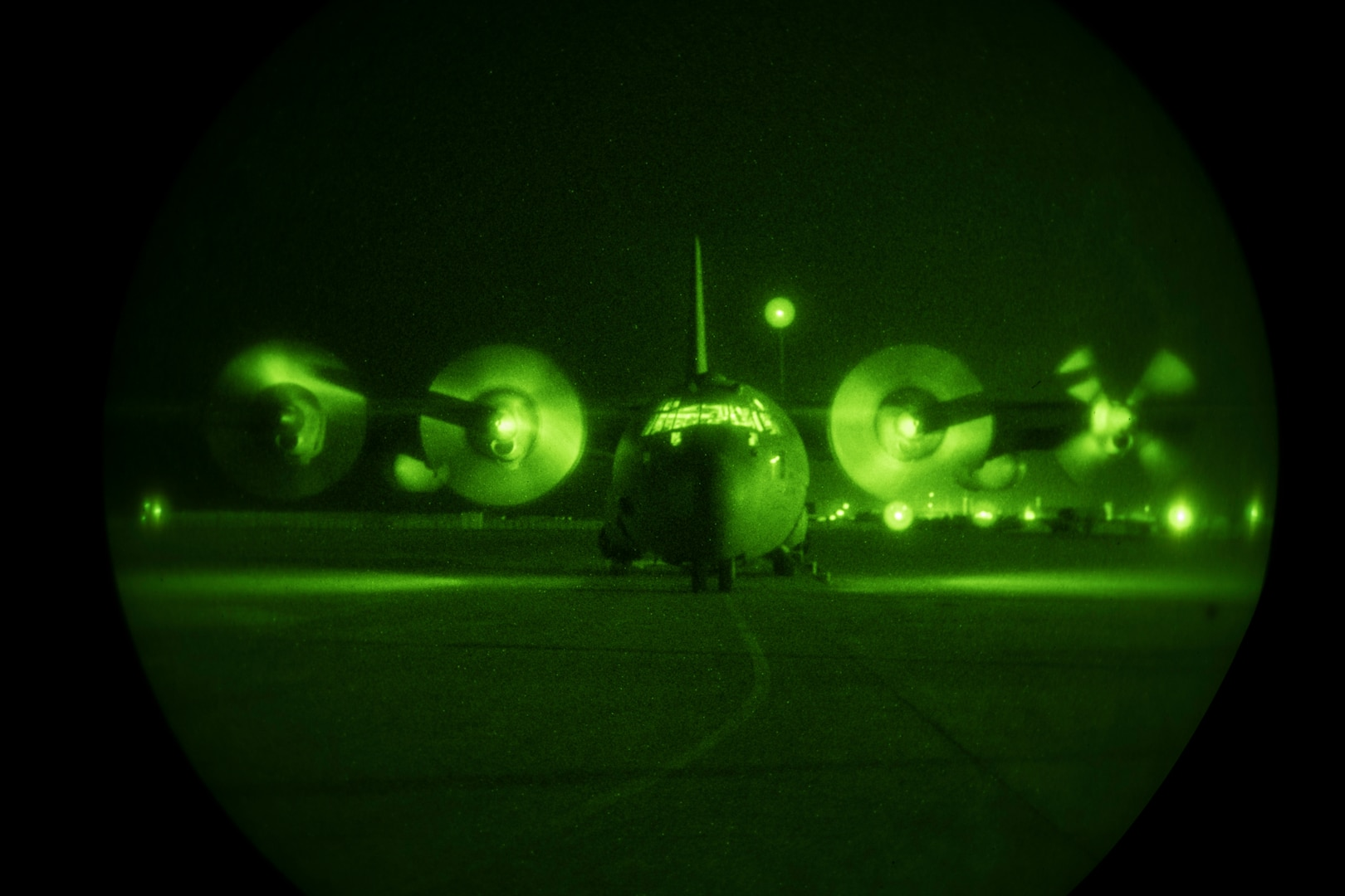 A U.S. Air Force C-130H Hercules assigned to the 746th Expeditionary Airlift Squadron at Al Udeid Air Base, Qatar, prepares to taxi down the runway.