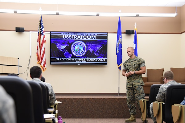 U.S. Marine Corps Staff Sgt. Jacob Simmons, U.S. Strategic Command (USSTRATCOM) Global Operations Center warning systems controller, teaches Offutt Air Force Base, Neb., junior-enlisted military members about U.S. Marine Corps traditions and history during the inaugural Junior Enlisted Professional Development Seminar, July 19, 2018. During the seminar, junior-enlisted members discussed a variety of topics with USSTRATCOM non-commissioned officers, petty officers and senior leaders. Topics included leadership, junior-enlisted roles and responsibilities, mentoring, military traditions and history, educational benefits, and customs and courtesies. USSTRATCOM has global responsibilities assigned through the Unified Command Plan that include strategic deterrence, nuclear operations, space operations, joint electromagnetic spectrum operations, global strike, missile defense, and analysis and targeting.