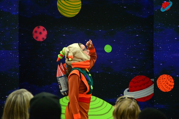 """Brilyn Cotner wanders the galaxy as Gulliver in Missoula Children's Theatre's rendition of """"Gulliver's Travels"""" July 20, 2018, at the Youth Center on Dover Air Force Base, Del. The Missoula Children's Theatre travels the world giving children a glimpse inside the world of entertainment and the preforming arts. (U.S. Air Force photo by Airman 1st Class Dedan D. Dials)"""