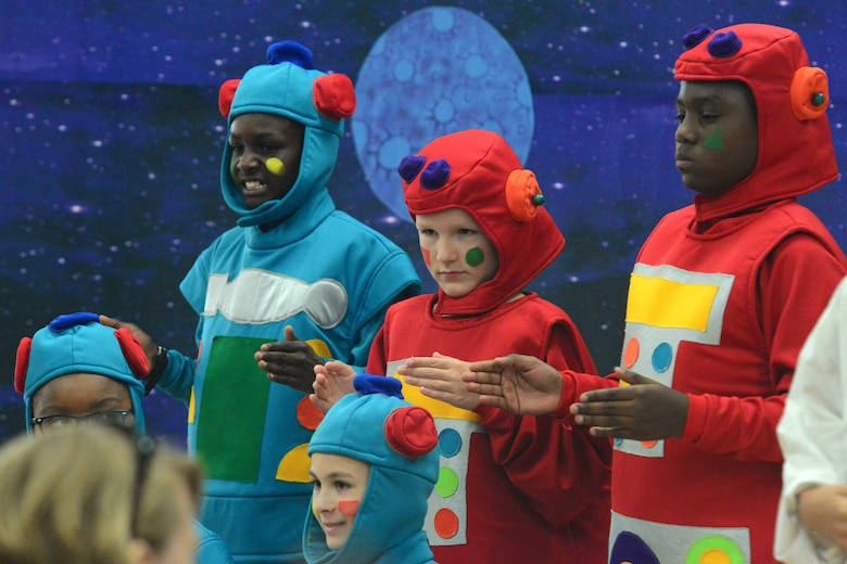"The five robots of Lapunta, portrayed by Mi'ky Neal, Roderick Freeman, Alec Mutter, Parker Cotner and Joseph Coake, play the role of evil henchmen during ""Gulliver's Travels"" July 20, 2018, at Dover Air Force Base, Del. Later, these same characters helped teach math and science to the other aliens in the cosmos. (U.S. Air Force photo by Airman 1st Class Dedan D. Dials)"