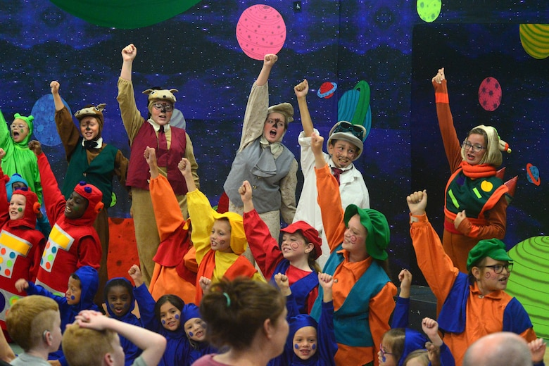 "A group of children act out the final scene in Missoula Children's Theatre's production of ""Gulliver's Travels"" July 20, 2018, at Dover Air Force Base, Del. This scene marked the end of the theatre company's visit to the base. (U.S. Air Force photo by Airman 1st Class Dedan D. Dials)"