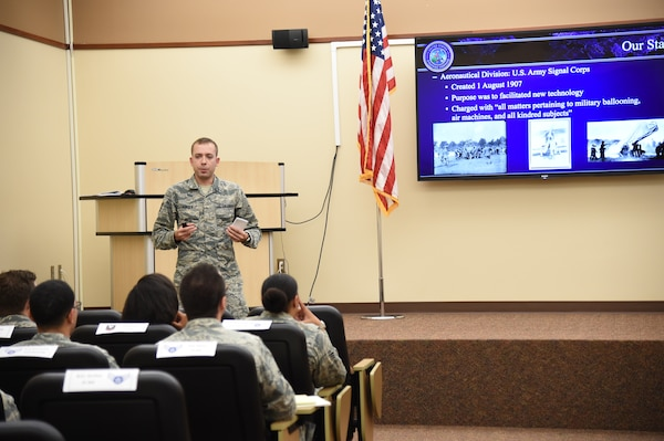 U.S. Air Force Tech. Sgt. Michael Furger, noncommissioned officer in charge of source collection management, teaches Offutt Air Force Base, Neb., junior-enlisted military members about U.S. Air Force history during the inaugural Junior Enlisted Professional Development Seminar, July 19, 2018. During the seminar, junior-enlisted members discussed a variety of topics with USSTRATCOM non-commissioned officers, petty officers and senior leaders. Topics included leadership, junior-enlisted roles and responsibilities, mentoring, military traditions and history, educational benefits, and customs and courtesies. USSTRATCOM has global responsibilities assigned through the Unified Command Plan that include strategic deterrence, nuclear operations, space operations, joint electromagnetic spectrum operations, global strike, missile defense, and analysis and targeting.