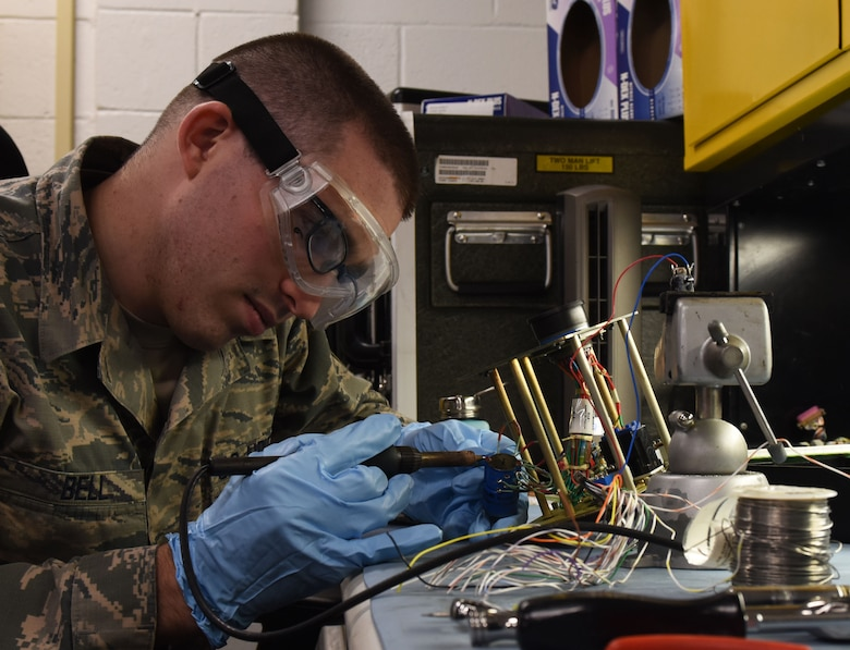 U.S. Air Force Staff Sgt. Ryan Bell, 20th Civil Maintenance Squadron avionics system technician, works on an avionics power panel at Shaw Air Force Base, S.C., July 23, 2018.