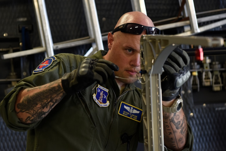 Master Sgt. Bryan Florian, Delaware Air National Guard 142nd Aeromedical Evacuation Squadron flight medic, assembles a stanchion litter system during aeromedical evacuation training aboard a C-5M Super Galaxy July 12, 2018, at Dover Air Force Base, Del. The SLS can be assembled in several configurations and carry up to four patients. The 142nd AES is stationed at New Castle Air National Guard Base, Del. (U.S. Air Force photo by Airman 1st Class Zoe M. Wockenfuss)