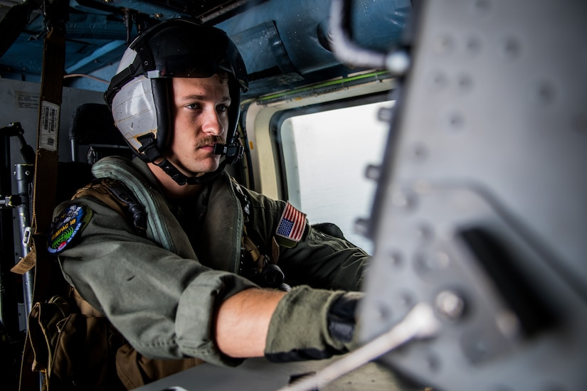Navy Petty Officer 3rd Class Chad Wiltshire operates a console aboard an MH-60R Sea Hawk helicopter assigned to Helicopter Maritime Strike Squadron 35 during the Rim of the Pacific exercise in the Pacific Ocean.