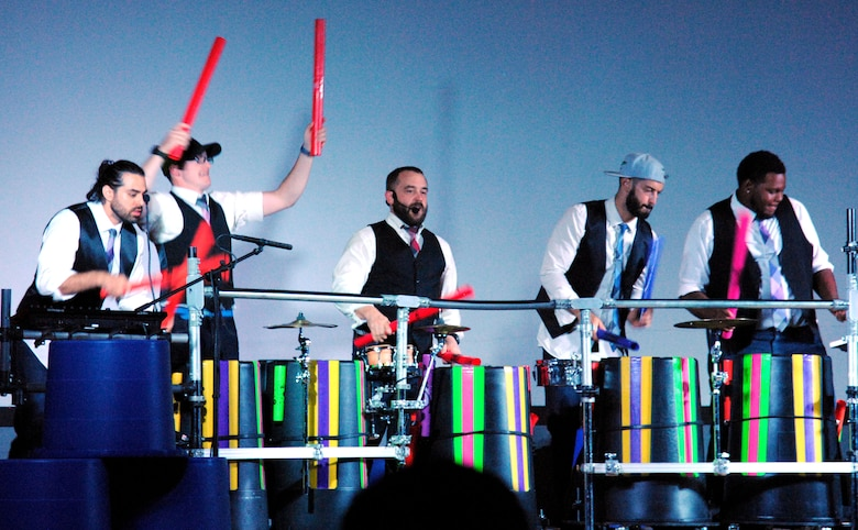Jeremy Price (center), creator of Plastic Musik, and members of his band use boom whackers as musical instruments during a concert at the base theater here July 21. The band is on tour and has performed at several other Air Force bases along the way. (U.S. Air Force photo by Jessie Perkins)