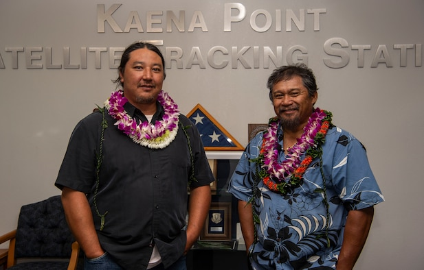 Jason Fukumoto, Detachment 3, 21st Space Operations Squadron electrician, and Robin Albios, Det. 3, 21st SOPS heating, ventilation and air conditioning specialist, pose for a photo after receiving the Air Force Civilian Award for Valor at the Kaena Point Satellite Tracking Station, Hawaii, July 23, 2018. Two years ago, Fukumoto and Albios provided medical aid to a state of Hawaii volunteer field crew member who suffered from smoke inhalation during a fire at the Kuaokala Game Management Area. (U.S. Air Force photo by Tech. Sgt. Heather Redman)