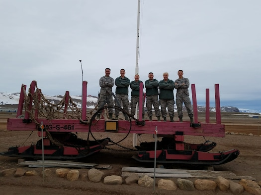 THULE AIR BASE, Greenland – (From left) Lt. Col. Fred Brooks, 2nd Lt. Ben Taylor, Tech. Sgt. Stephanie Beal, 1st Lt. Matthew Hoff, Chief Master Sgt. Jill Loyle and 1st Lt. Derrick Rule, form the Air National Guard team that traveled to Thule Air Base, Greenland, to inspect bridges and assess buildings, June 5-16, 2018. Once the team's building assessments are uploaded in the BUILDER Sustainment Management System, the Air Force can use this tool to decide what projects receive funding at Thule AB. (Courtesy photo)