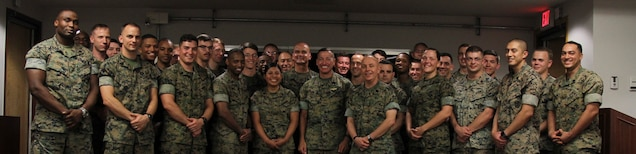 USAG CAMP HUMPHREYS, Korea – Sgt. Maj. Anthony A. Spadaro (center), U.S. Pacific Command senior enlisted leader, with Marines from U.S. Marine Corps Forces Korea, after speaking with them about the current environment on the peninsula here, July 12. Spadaro spent the day at MARFORK motivating the Marines and talking about his experiences as a leader in the Asian Pacific as well as his thoughts on the current climate. (U.S. Marine Corps photo by Sgt. Nathaniel Hanscom/Released)