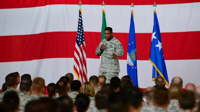 Chief Master Sgt. Phillip L. Easton, U.S. Air Forces in Europe and Air Forces Africa command chief, speaks with Airmen at an all call during a visit to Aviano Air Base, Italy, July 23, 2018. Easton spoke on the importance of Airmen and families to take time to recharge and come back to complete the mission safely and efficiently. (U.S. Air Force photo by Staff Sgt. Cary Smith)