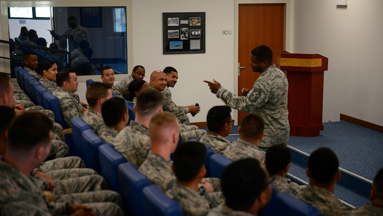 Chief Master Sgt. Phillip L. Easton, U.S. Air Forces in Europe and Air Forces Africa command chief, speaks with Airmen at Airmen Leadership School during a visit to Aviano Air Base, Italy, July 23, 2018. Easton mentioned several key words of advice to the Airmen on what it means to be a front-line supervisor in the Air Force. (U.S. Air Force photo by Staff Sgt. Cary Smith)