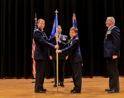 Col. Katharine Barber (middle), accepts command of the National Air and Space Intelligence Center's Space, Missiles and Forces Intelligence Group from Col. Parker Wright, NASIC commander, July 6. SM is responsible to deliver integrated, predictive intelligence on space, ballistic missile, regional and future threat capabilities to enable U.S. decision-making advantage in the air, space and cyber domains. (U.S. Air Force photo/ Senior Airman Samuel Earick)