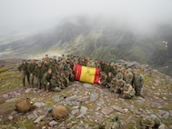 Col. Brian W. Neil, commander, U.S. Marine Corps Security Forces Regiment, poses with Marines from MCSF battalion Bangor and MCSF battalion Kings Bay, along with their counterparts from the British Royal Marines on their hike of An Teallach Mountain in Scotland, UK. This was part of the joint exercise, Operation Tartan Eagle, in which US Marines went to train with the British Royal Marines in the UK. (Official U.S. Marine Corps photo by Capt. Joseph Trippi/ Released)