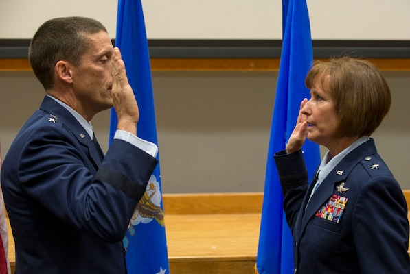 Maj. Gen. Robert Skinner, Air Forces Cyber commander, administers the Oath of Office to Brig. Gen. Michelle Hayworth, AFCYBER vice commander, during her promotion ceremony at Joint Base San Antonio-Lackland July, 16. In June, Hayworth re-joined AFCYBER from Air Force Space Command. She previously served in AFCYBER, most recently as the 688th Cyberspace Wing Commander.