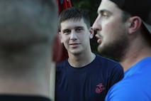 William Christianson, poolee, RSS Columbia, listens to one of the ruckers for the Marine Raider March talk about his experience in the Marine Corps before embarking on a portion of the 900 mile ruck on July 21, 2018, as they passed through Columbia, S.C. Marines and poolees joined the ruckers for 8 miles of their journey to honor service members who lost their lives in a aircraft crash a year ago. To support the march, follow the Marine Raider Memorial March on Facebook and visit their website at http://www.ruckingraiders.com. (U.S. Marine Corps photo by Sgt. Tabitha Bartley)