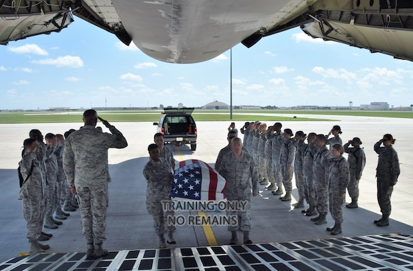 Citizen Airmen perform a mock dignified transfer of remains aboard a C-5M Super Galaxy at Joint Base San Antonio-Lackland July 14. The training was for Reserve Citizen Airmen chaplain candidates. The candidates are with the Air Force Chaplain Candidate Program, who after graduation and an ecclesiastical endorsement, are then eligible to become chaplains in the U.S. Air Force Reserve, Air National Guard or active duty component.